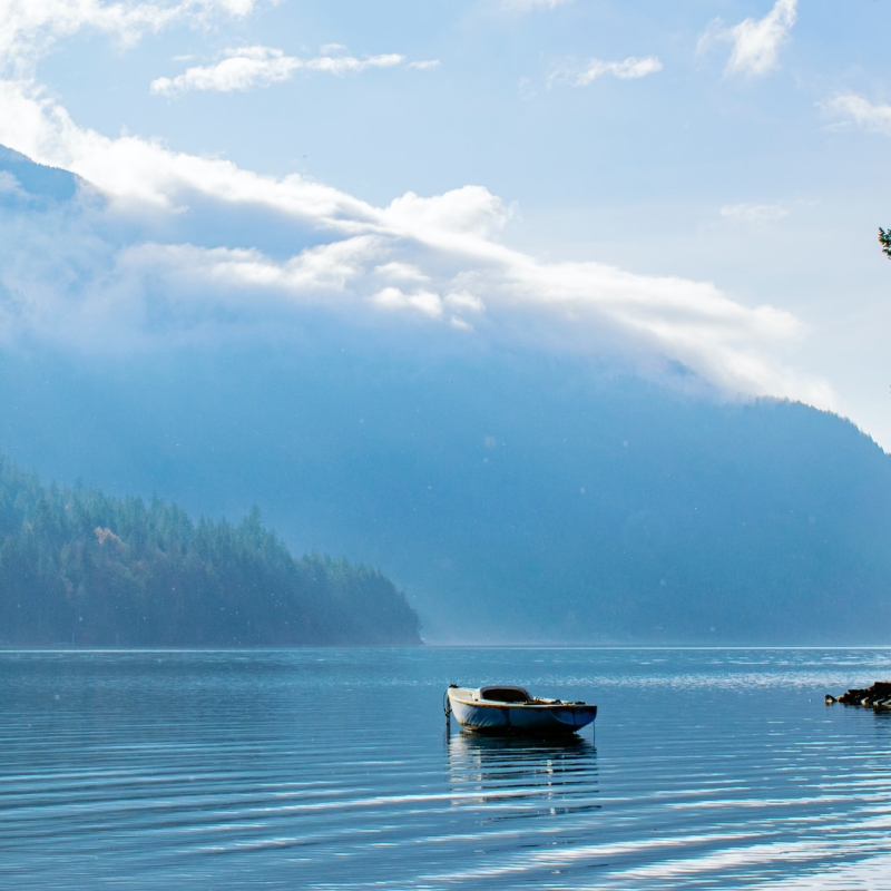 An empty row boat sits on Harrison Lake in British Columbia.