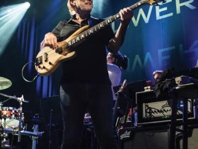 Rocco Prestia plays bass at a concert.